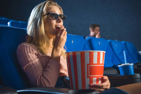 Side View Young Woman Glasses Popcorn Watching Film Alone Cinema — стоковое фото